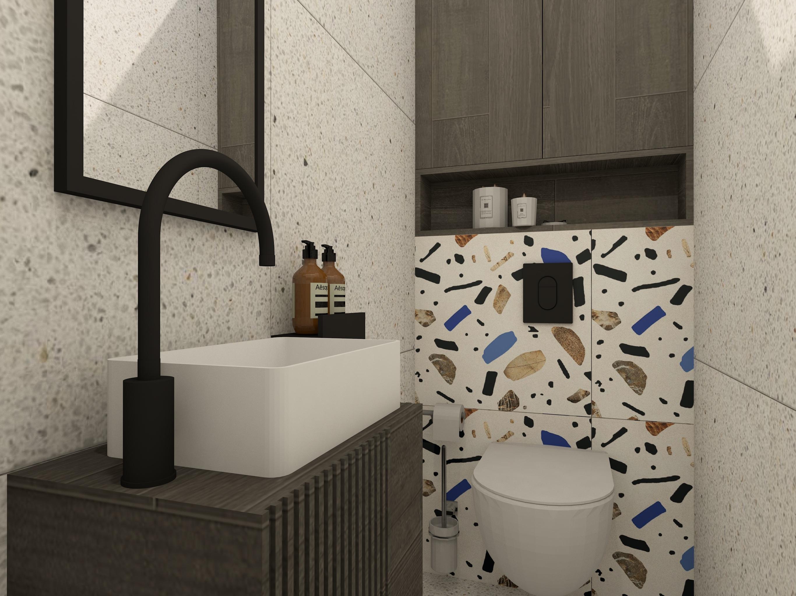 Projekt małej toalety w bloku z płytkami w stylu lastryko i czarnymi elementami