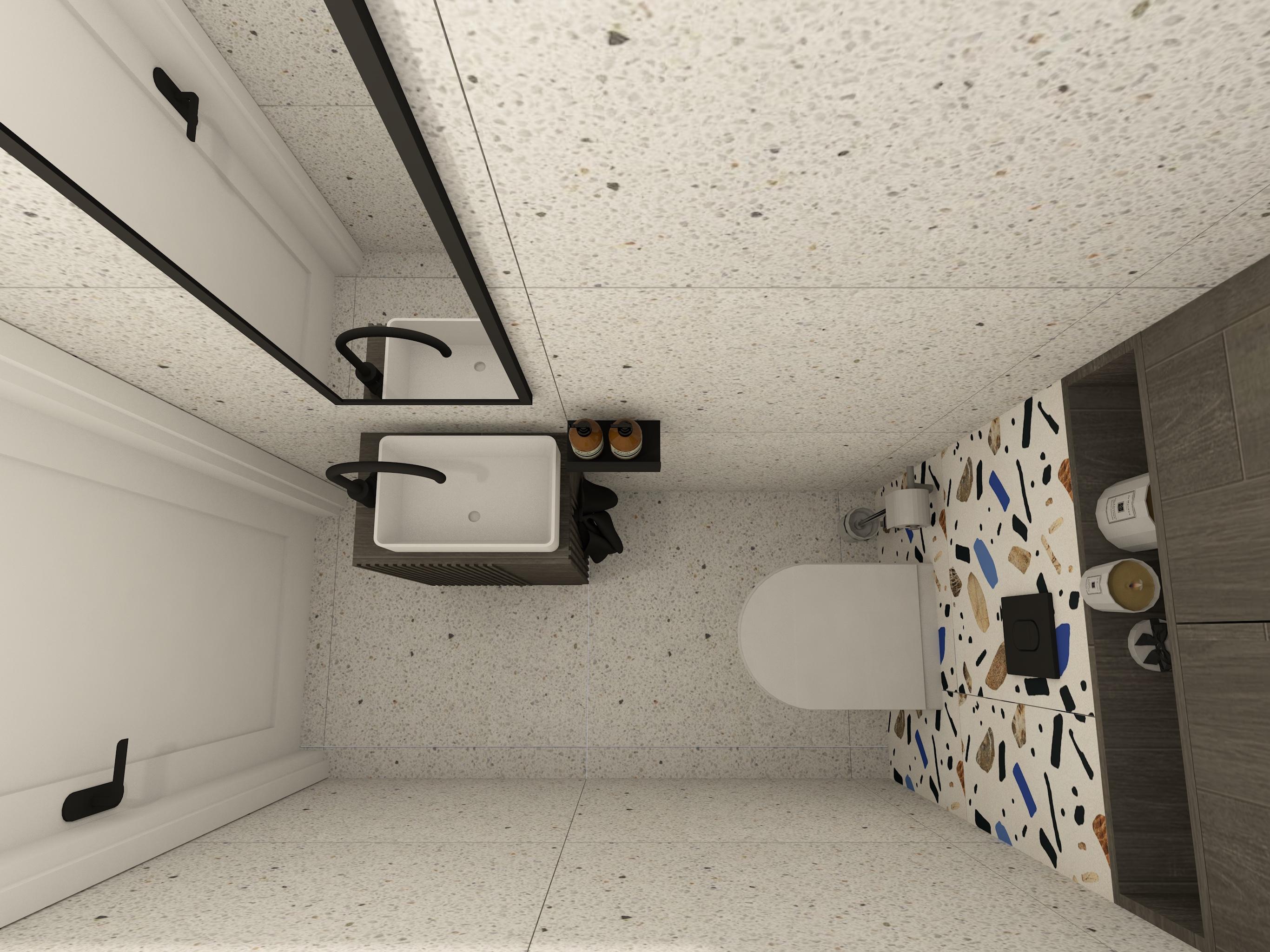 Projekt małej łazienkie w bloku z płytkami patchwork i geberitem