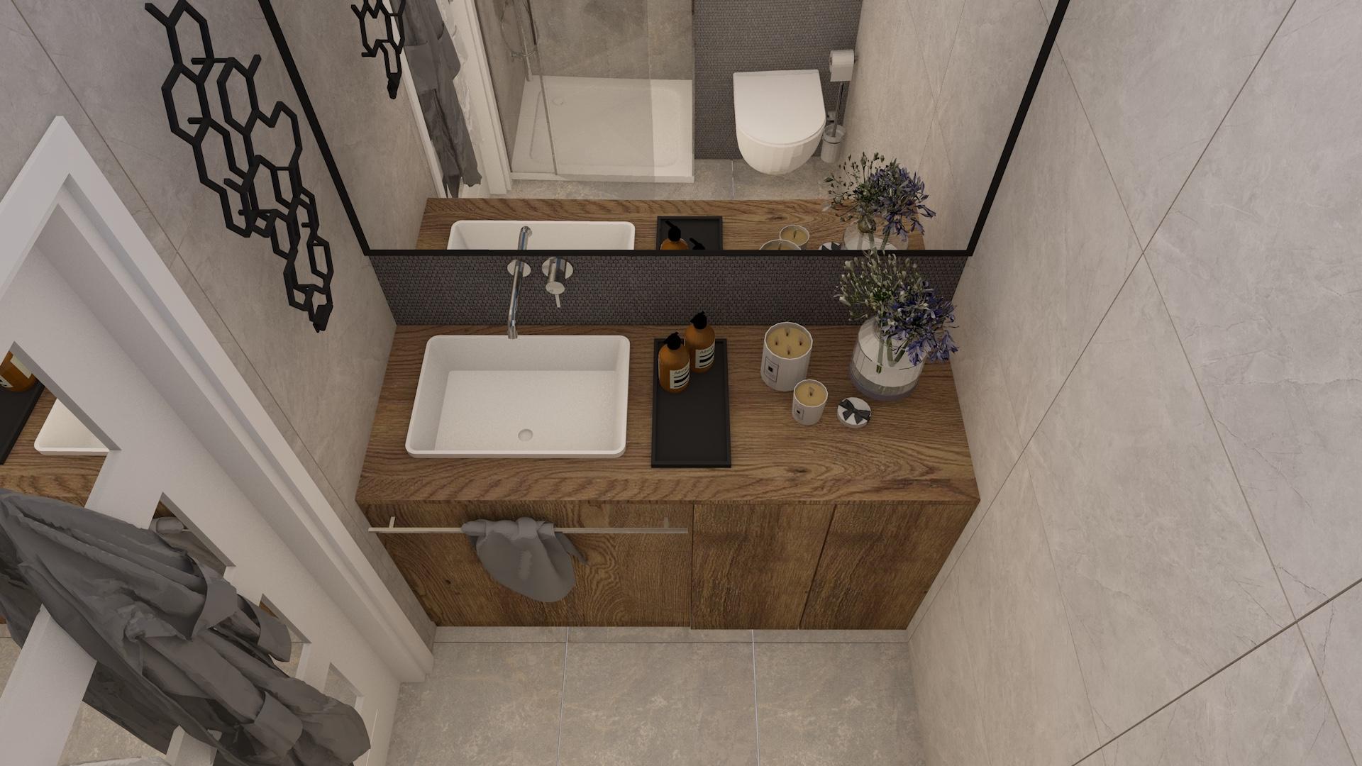 Projekt nowoczesnej łazienki z płytkami imitującymi kamień i drewnianą szafką pod umywalkę