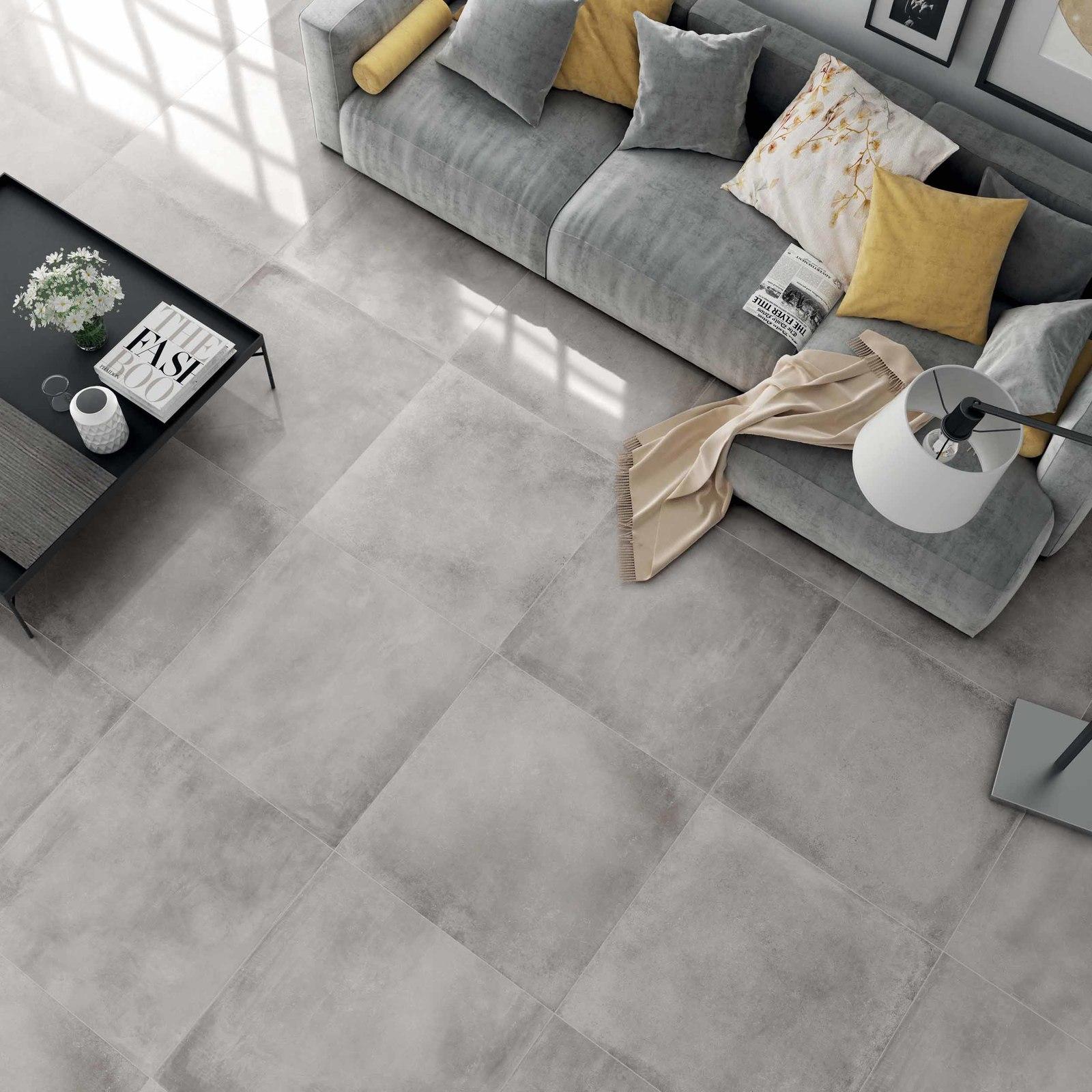 Salon z szarymi matowymi płytkami imitującymi beton