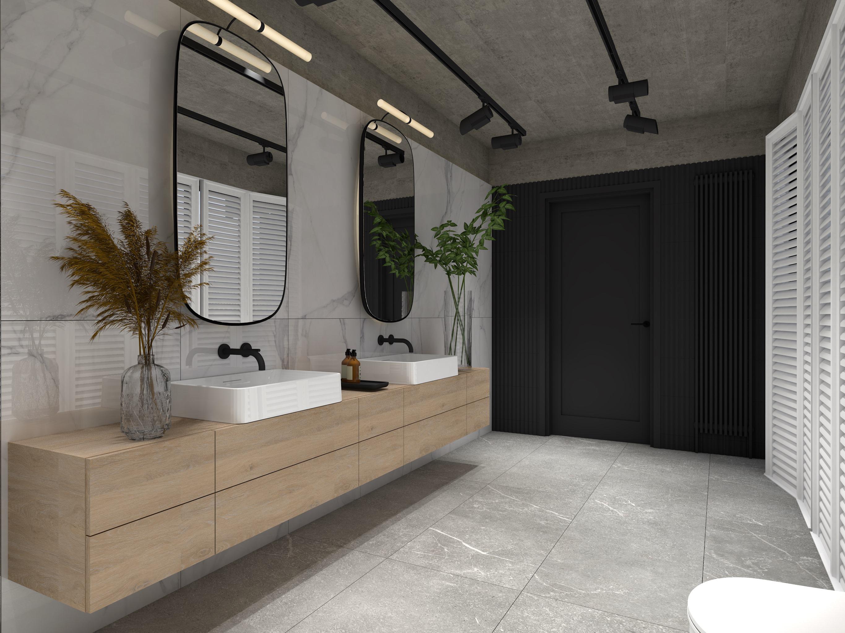 Duża łazienka z drewnianą szafką wiszącą, dwoma umywalkami i lustrami, jedną czarną ścianą, szarą podłogą, czarnymi lampami szynowymi i płytkami Pontremoli Brillo na ścianie