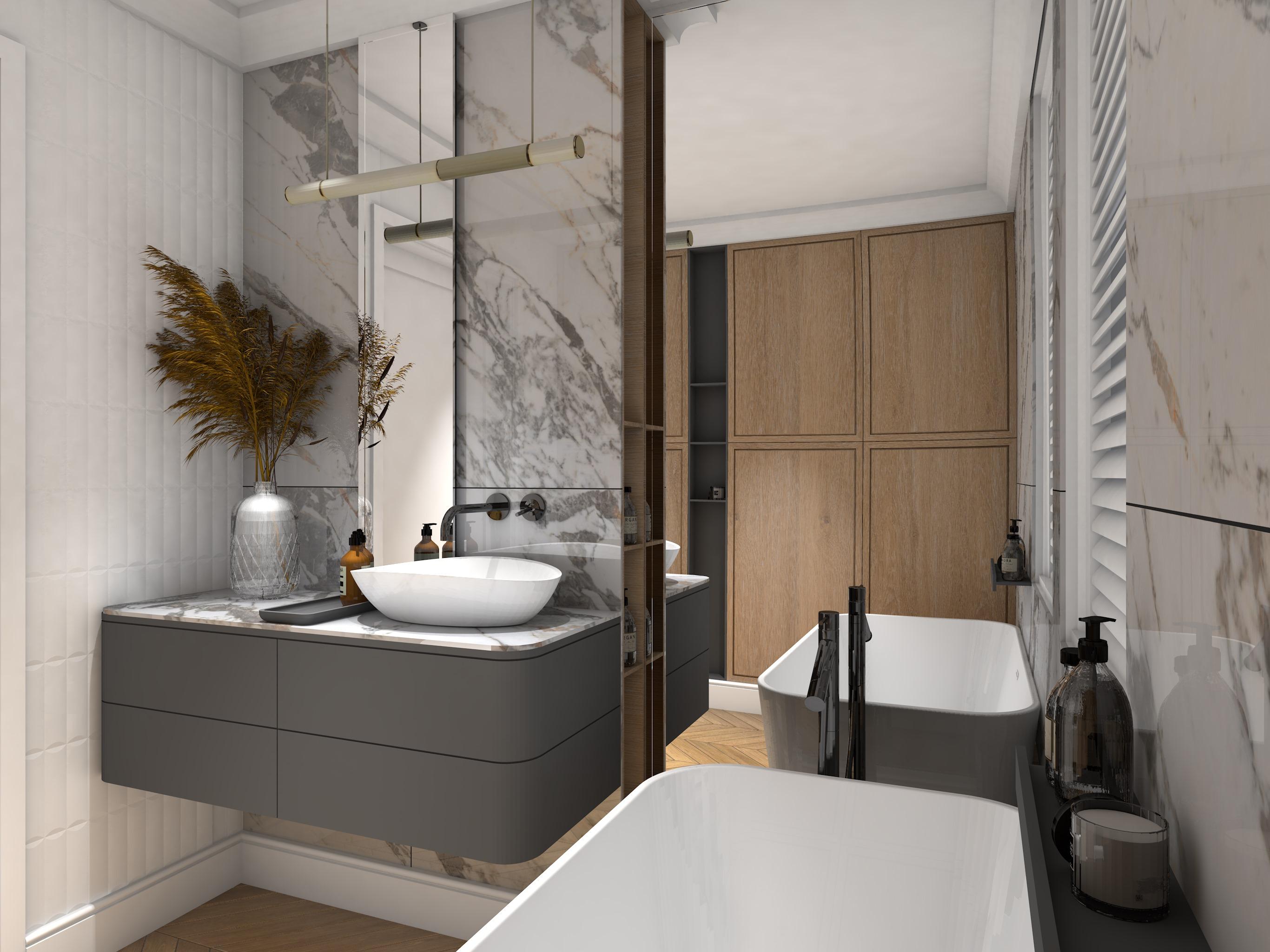 Jasna łazienka z szarą szafką wiszącą, białą umywalką nablatową, lampą wiszącą, dużym lustrem i płytkami Veins Gold Brillo