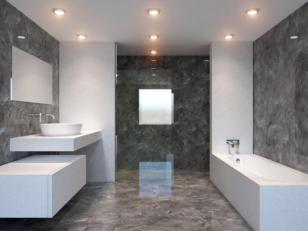 Łazienka wyłożona ciemnymi płytkami imitującymi marmur w połysku z zabudowaną wanną, kamienną półką z umywalką nablatową, prostokątnym lustrem i kabiną prysznicową
