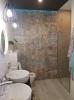 realizacja bardzo nowoczesnej łazienki z płytkami carpet vestige