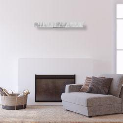 kinkiet PIERCE WHITE 24W LED na białej ścianie z kominkiem i szarym fotelem