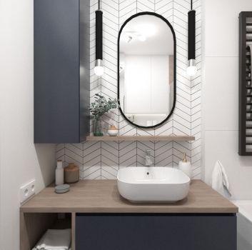 Multikolorowa łazienka z grafitową szafką z umywalką nablatową, wanną wolnostojącą i toaletą