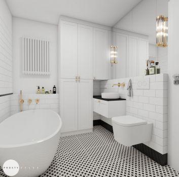 Biało-czarna łazienka z wanną wolnostojącą, toaletą oraz czarnym blatem na którym stoi umywalka nablatowa