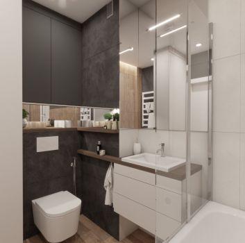 Szaro-beżowa łazienka z wanną, toaletą oraz białą szafką z umywalką nablatową