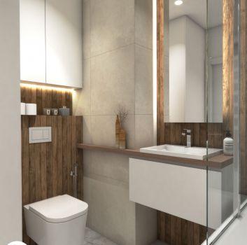 Szara łazienka z wanną, toaletą oraz białą szafką z umywalką nablatową