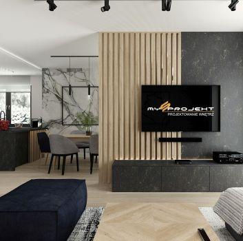 Szaro-drewniany salon z telewizorem, marmurową szafką pod nim oraz szarym narożnikiem z drewnianym stołem