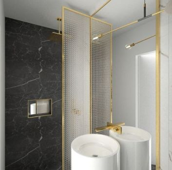 Biało-szara łazienka ze złotym prysznicem, umywalką wolnostojącą oraz toaletą