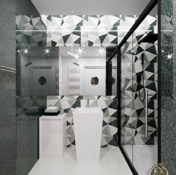 Biało-szara łazienka z czarnym prysznicem, białą umywalką wolnostojącą oraz toaletą