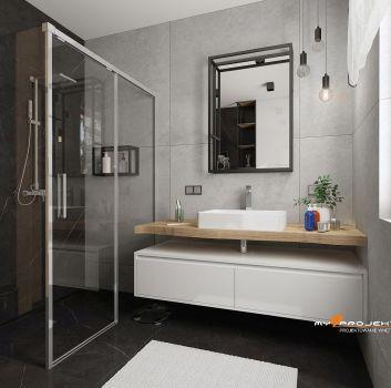 Szara łazienka z prysznicem, białą szafką z umywalką nablatową oraz toaletą