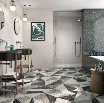 Szara łazienka z prysznicem, zabudowaną wanną oraz dwoma umywalkami w kształcie misek