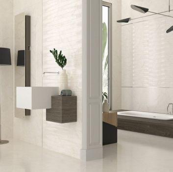 Beżowa łazienka z zabudowaną wanną oddzieloną ścianą oraz oryginalną umywalką z małą szafeczką
