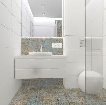 Biała łazienka z prysznicem, białą półką z umywalką nablatową oraz toaletą