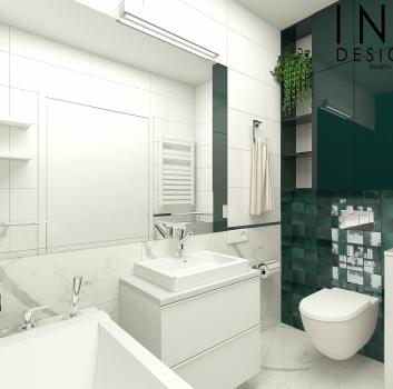 Biało-zielona łazienka z toaletą, wanną oraz białą szafką z umywalką nablatową