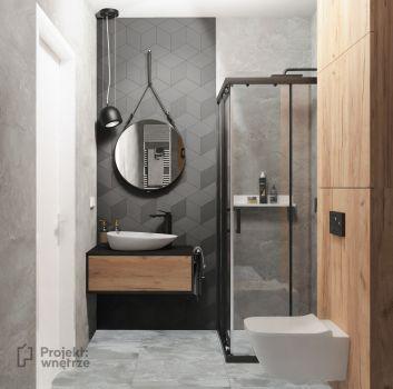 Szara łazienka z czarnym prysznicem, toaletą oraz drewnianą szafką z umywalką nablatową