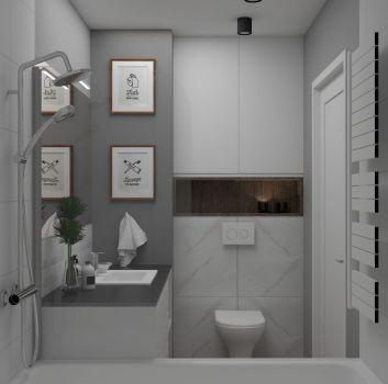 Biało-szara łazienka z wanną, toaletą oraz białą szafką z umywalką nablatową