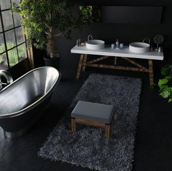 Czarna łazienka z srebrną wanną wolnostojącą, białym blatem z dwoma umywalkami nablatowymi oraz dużą ilością roślin