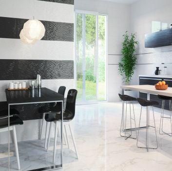 Biało-czarna kuchnia z czarnym stołem z czterema połyskującymi krzesłami, drewnianym blatem pośrodku oraz dużym oknem