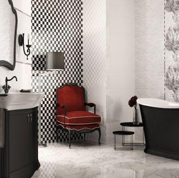 Biało-czarna łazienka z czarną wanną wolnostojącą, czerwonymi siedziskami oraz wbudowaną w brązową szafkę umywalką