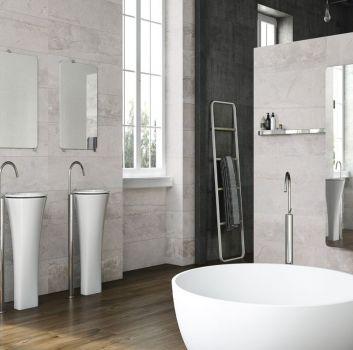 Beżowa łazienka z okrągłą wanną wolnostojącą, dwoma wolnostojącymi umywalkami i ścianką oddzielającą łazienkę od innego pomieszczenia