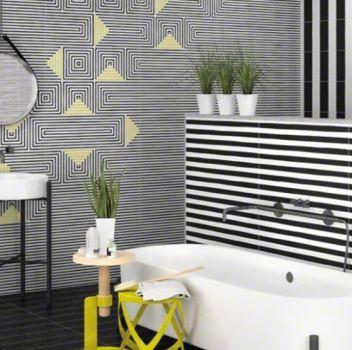 Biało-czarna łazienka z wanną wolnostojącą, dwoma umywalkami na geometrycznych stelażach oraz dwóch okrągłych nóżkach