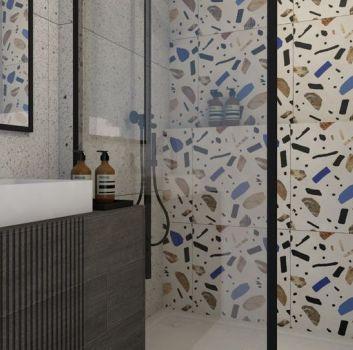 Mała łazienka w bloku z kolorowymi płytkami lastryko oraz prysznicem