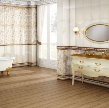 Beżowo-brązowa łazienka z wanną wolnostojącą, dużym oknem oraz dwoma umywalkami wbudowanymi w dekoracyjną szafkę