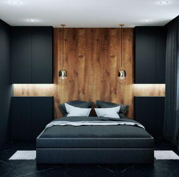 Czarna sypialnia z grafitowym łóżkiem, drewnianymi wnękami w formie półek oraz dwoma, złotymi lampami