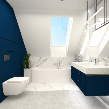 Biało-szara łazienka z wanną wolnostojącą, toaletą oraz granatową szafką z umywalką nablatową