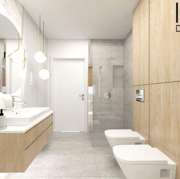 Biało-szara łazienka z prysznicem, toaletą oraz drewnianą szafką z umywalką nablatową