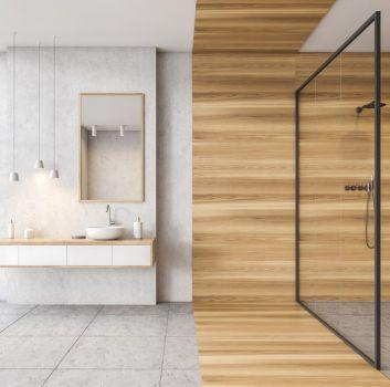 Łazienka z białą wiszącą szafką, białą umywalką nablatową, prostokątnym lustrem i kabiną prysznicową bez brodzika